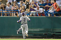 TCU's Brance Rivera makes a catch despite fan interferance in Game 6 of the NCAA Division One Men's College World Series on Monday June 21st, 2010 at Johnny Rosenblatt Stadium in Omaha, Nebraska.  (Photo by Andrew Woolley / Four Seam Images)