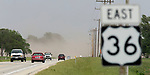 May 17, 2017- Tuscola, IL- Cars enter and exit a dust cloud moving across Route 36 just east of Filson Road. A combination of high winds and dry topsoil created the hazard which resulted in a multi-car accident at this location. [Photo: Douglas Cottle]