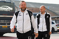 (L-R) Billy Reid, assistant manager for Swansea and Adrian Tucker, goalkeeping coach for Swansea arrive prior to the game during the Sky Bet Championship match between Nottingham Forest and Swansea City at City Ground, Nottingham, England, UK. Saturday 30 March 2019