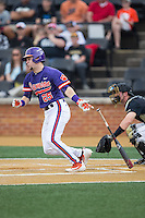 Chris Okey (25) of the Clemson Tigers follows through on his swing against the Wake Forest Demon Deacons at David F. Couch Ballpark on March 12, 2016 in Winston-Salem, North Carolina.  The Tigers defeated the Demon Deacons 6-5.  (Brian Westerholt/Four Seam Images)