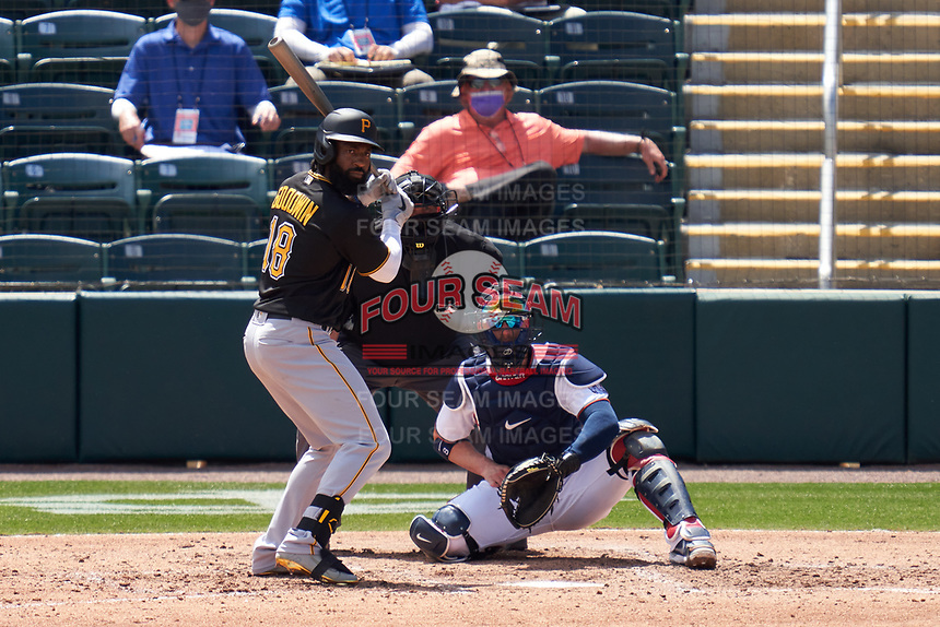 Pittsburgh Pirates Brian Goodwin (18) bats during a Major League Spring Training game against the Minnesota Twins on March 16, 2021 at Hammond Stadium in Fort Myers, Florida.  Also shown is umpire Fieldin Culbreth and catcher Michael Perez.  (Mike Janes/Four Seam Images)
