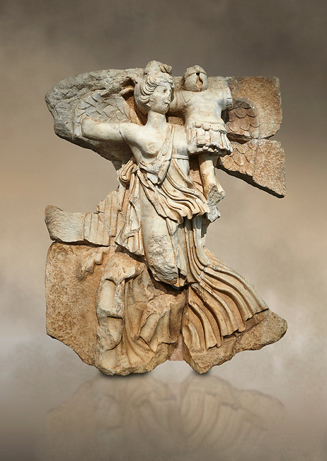 Roman Sebasteion relief  sculpture of the goddess Victory, Aphrodisias Museum, Aphrodisias, Turkey.  Against an art background.<br /> <br /> A winged goddess Victory( Nike) flies past carrying a military trophy. She wears a long light dress and has one breast and one leg exposed. Her clothing is set in motion by her swift flight.