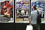 "May 3, 2010 - Tokyo, Japan - A visitor looks at posters during the Treasure Festa 2010 at Tokyo Big Sight, Japan, on May 4, 2010. Some visitors and hobbyists concentrate specifically on a certain type of figure, such as garage kits, gashapon, or PVC bishojo (pretty girl) statues. According to many who study the phenomenon, many 'figure moe zoku', a Japanese term which refers to ""Otaku who collect figurines"", have difficulty in navigating modern romantic life and prefer to go on ""dates"" with their favorite figurine during off hours."