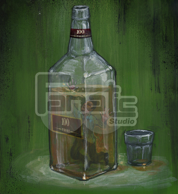 Conceptual image of man drowning in alcohol bottle