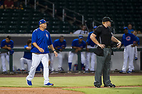 AZL Cubs manager Carmelo Martinez approaches home plate umpire Ray Patchen after Yovanny Cuevas (not pictured) was called out for batter interference against the AZL Giants on September 6, 2017 at Sloan Park in Mesa, Arizona. AZL Giants defeated the AZL Cubs 6-5 to even up the Arizona League Championship Series at one game a piece. (Zachary Lucy/Four Seam Images)
