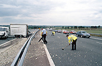 Traffic police officers are clearing up after a road traffic accident on the motorway. A van and trailer crashed into the central armco barrier and rolled over onto the opposite carriageway causing oncoming traffic to swerve causing accidents on that side of the motorway. The police officers have closed one side totally and closed lanes two and three of the other carriageway. There is a considerable tailback forming due to the accident...© SHOUT. THIS PICTURE MUST ONLY BE USED TO ILLUSTRATE THE EMERGENCY SERVICES IN A POSITIVE MANNER. CONTACT JOHN CALLAN. Exact date unknown.john@shoutpictures.com.www.shoutpictures.com..