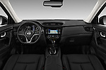 Stock photo of straight dashboard view of 2018 Nissan X-Trail Tekna 5 Door SUV Dashboard