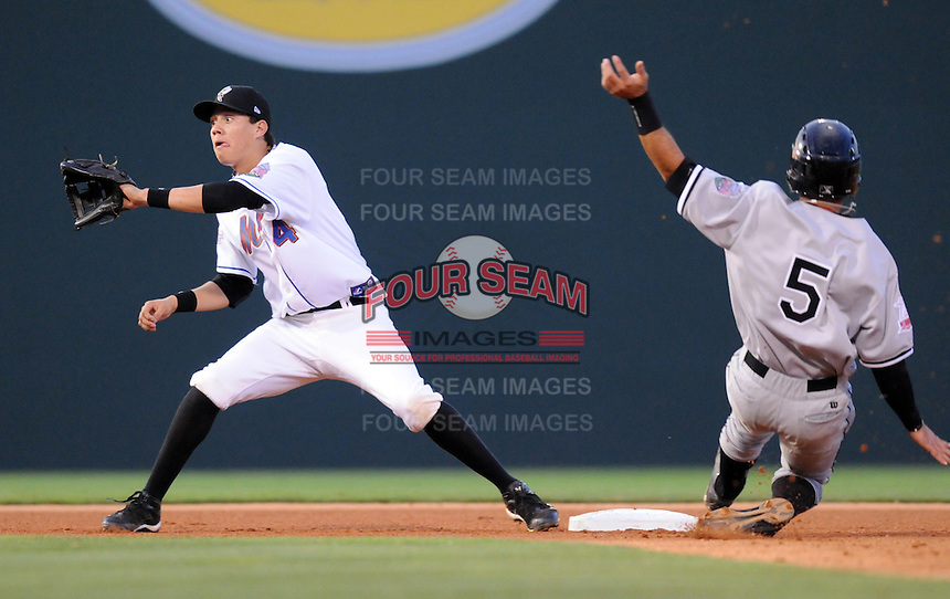 Wilmer Flores waits for the ball to tag Dan Wagner at the 2010 South Atlantic League All-Star Game on Tuesday, June 22, 2010, at Fluor Field at the West End in Greenville, S.C. Photo by: Tom Priddy/Four Seam Images