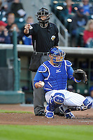 Home plate umpire Thomas Newsom calls a strike against the Omaha Storm Chasers  at Principal Park on July 2, 2014 in Des Moines, Iowa. The Cubs  beat Storm Chasers 4-3.   (Dennis Hubbard/Four Seam Images)
