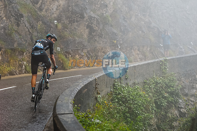 Søren Kragh Andersen (DEN) Team DSM climbs into the mist during Stage 8 of the 2021 Tour de France, running 150.8km from Oyonnax to Le Grand-Bornand, France. 3rd July 2021.  <br /> Picture: A.S.O./Charly Lopez   Cyclefile<br /> <br /> All photos usage must carry mandatory copyright credit (© Cyclefile   A.S.O./Charly Lopez)