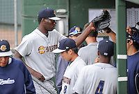 Pitcher Rafael De Paula (37) of the Charleston River Dogs is congratulated after coming out of a game against the Greenville Drive on Saturday, April 6, 2013, at Fluor Field at the West End in Greenville, South Carolina. De Paula, a free agent from the Dominican Republic, threw 4.1 innings, striking out 11 and giving up five hits and two runs. Charleston won Game 1 of a doubleheader, 6-2. De Paula did not figure in the decision. (Tom Priddy/Four Seam Images)