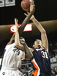 Nevada's Dario Hunt and Bucknell's Mike Muscala fight for a loose ball during a second round NIT college basketball game in Reno, Nev., on Sunday, March 18, 2012. Nevada won 75-67..Photo by Cathleen Allison