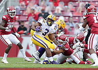 LSU running back Tyrion Davis-Price (3) carries the ball, Saturday, November 21, 2020 during the first quarter of a football game at Donald W. Reynolds Razorback Stadium in Fayetteville. Check out nwaonline.com/201122Daily/ for today's photo gallery. <br /> (NWA Democrat-Gazette/Charlie Kaijo)