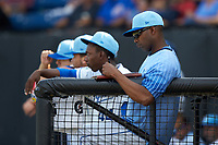 Burlington Royals pitching coach Carlos Martinez (40) makes notes during the Appalachian League game against the Johnson City Cardinals at Burlington Athletic Stadium on July 15, 2018 in Burlington, North Carolina. The Cardinals defeated the Royals 7-6.  (Brian Westerholt/Four Seam Images)