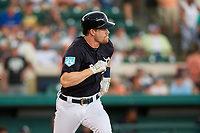Detroit Tigers second baseman Gordon Beckham (29) runs to first base during a Grapefruit League Spring Training game against the New York Yankees on February 27, 2019 at Publix Field at Joker Marchant Stadium in Lakeland, Florida.  Yankees defeated the Tigers 10-4 as the game was called after the sixth inning due to rain.  (Mike Janes/Four Seam Images)