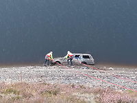 "Pictured: Brecon Mountain Rescue personnel scale down Llyn Brianne to examine an old Ford Sierra car discobered in mid Wales, UK.<br /> Re: Rescuers had to climb down the side of a reservoir to check if anyone was inside the old shell of a Ford Sierra car that was exposed after water levels dropped.<br /> Brecon Mountain Rescue Team were called by Dyfed Powys Police to investigate the strange discovery at Llyn Brianne Reservoir.<br /> Volunteers used ropes to get to and inspect the car.<br /> The service tweeted: ""The vehicle had been there for many years & (more importantly) was unoccupied""."