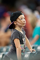 A young fan watches the lighting in the distance during the first game of a doubleheader between the Lynchburg Hillcats and the Potomac Nationals on June 9, 2018 at Calvin Falwell Field in Lynchburg, Virginia.  Lynchburg defeated Potomac 5-3.  (Mike Janes/Four Seam Images)