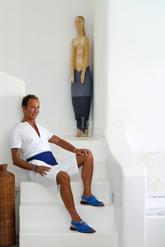 Illustrious Greek designer and businessman Lakis Gavlas's villa in Mykonos is the location of many of summer's most exclusive parties complete with glitz, glamour and international celebrities.  Gavalas has filled his home with many modern and contemporary art pieces accented by eccentric design objects.