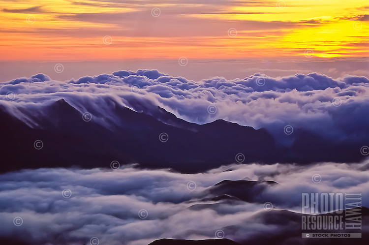 """Predawn colors and a sea of clouds in Haleakala """"Crater"""" as seen from 9,745 feet in Haleakala National Park, Maui."""
