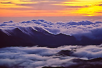 "Predawn colors and a sea of clouds in Haleakala ""Crater"" as seen from 9,745 feet in Haleakala National Park, Maui."