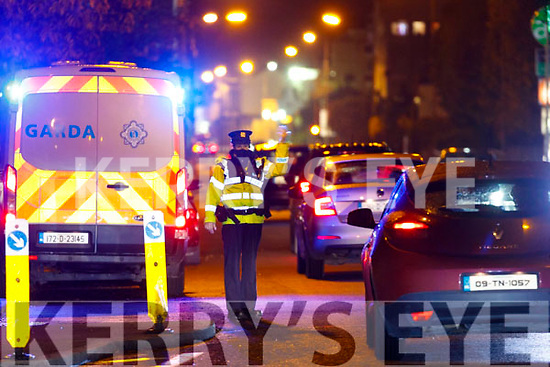 Garda Eilis Cronin on duty at a checkpoint in Oakpark, Tralee on Tuesday night.