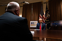 United States President Donald J. Trump listens during a meeting with members of the National Association of Police Organizations Leadership in the Cabinet Room of the White House in Washington, DC, on July 31st, 2020.<br /> Credit: Anna Moneymaker / Pool via CNP /MediaPunch