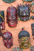 Nepal, Kathmandu, Swayambhunath.  Masks for Sale.