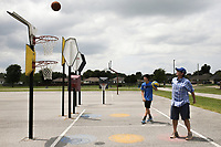 Aaron Anderson of Springdale(right) and A.P. Anderson, 13, (left) play bankshot basketball, Sunday, August 1, 2021 at the bank shot basketball court at Ward Nail Park in Lowell. Check out nwaonline.com/210802Daily/ for today's photo gallery. <br /> (NWA Democrat-Gazette/Charlie Kaijo)