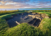 The recessed box beds and harth of one of the 8 houses of the Neolithic Barnhouse Settlement archaeological site, circa 3000 BC,  Loch of Harray, Orkney Mainland, Scotland,
