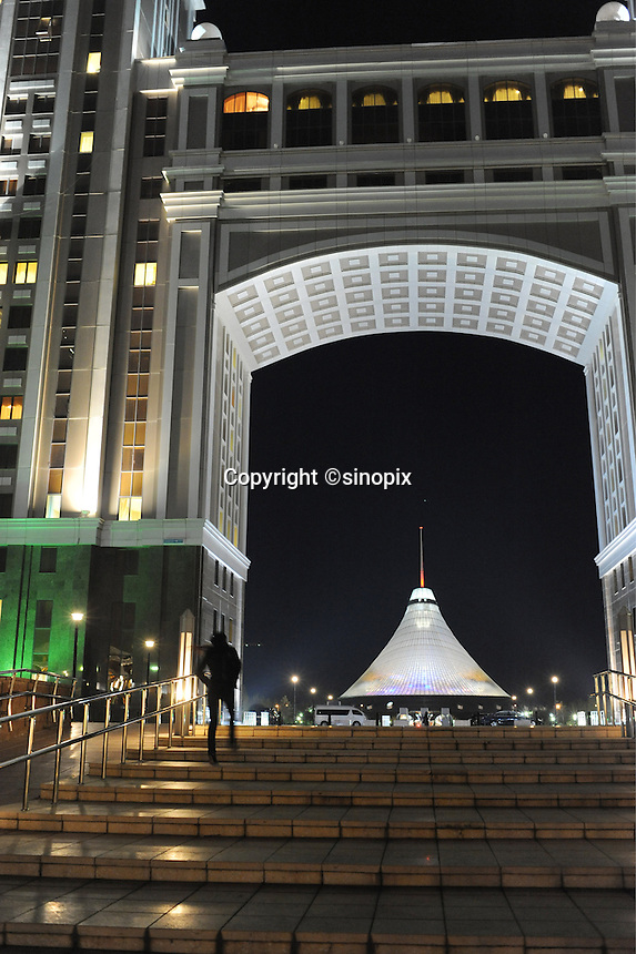 The massive tented shopping center is seen through the arch of a new building in Astana, the capitol of Kazakstan.<br />