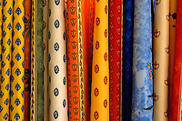 Selection of colorful patterned textiles at the market in  Moustiers-Sainte-Marie, Provence, France.