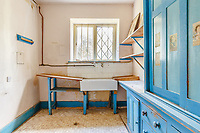 BNPS.co.uk (01202) 558833. <br /> Pic: Strutt&Parker/BNPS<br /> <br /> Pictured: Utility room. <br /> <br /> Nun like it...<br /> <br /> A former convent that has hardly been touched in 80 years is on the market for £450,000.<br /> <br /> Until recently Posbury House was home to an Anglican Franciscan nunnery which moved to the Devon property to escape the danger of German bombardment in the Second World War.<br /> <br /> The eight-bedroom manor house and two acres of gardens have been well looked after by the nuns, but the property is now in need of refurbishment and buyers are relishing the idea of a project.<br /> <br /> Estate agents Strutt & Parker say the property has attracted an extraordinary amount of interest with more than 150 viewings in just ten days. They are now asking for best and final offers by midday on Wednesday.