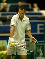 20-2-06, Netherlands, tennis, Rotterdam, ABNAMROWTT, Wesley Moodie in action against Gilles Simon
