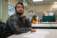 Student veteran Daniel Robles listens as UAA financial aid counselor Chandera Tolley presents a scholarship workshop in UAA's Multicultural Center in Rasmuson Hall.