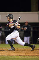 Forrest Brandt (10) of the Davidson Wildcats follows through on his swing against the Wake Forest Demon Deacons at Wilson Field on March 19, 2014 in Davidson, North Carolina.  The Wildcats defeated the Demon Deacons 7-6.  (Brian Westerholt/Four Seam Images)