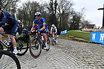 The peloton summit the Muur van Geraardsbergen during the 76th edition of Omloop Het Nieuwsblad 2021 running 200km from Gent to Ninove, Belgium. 27th February 2021  <br /> Picture: Serge Waldbillig | Cyclefile<br /> <br /> All photos usage must carry mandatory copyright credit (© Cyclefile | Serge Waldbillig)