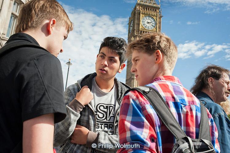 Tourists beneath Big Ben, Westminster, London