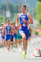 24 JUN 2012 - KITZBUEHEL, AUT - Alistair Brownlee (GBR) of Great Britain (right) breaks away from the front pack during the early stages of the first lap of the run at the elite men's 2012 World Triathlon Series round in Schwarzsee, Kitzbuehel, Austria .(PHOTO (C) 2012 NIGEL FARROW)