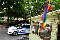 NEW YORK, NY - JUNE 1 : A NYPD car drives near a LGBTQ flag on June 1, 2021. in New York City. New York City's Pride events organizers banned police and other law enforcement from marching during annual parade until 2025. (Photo by Eduardo MunozAlvarez/VIEWpress)