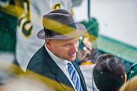 14 February 2015: University of Vermont Catamount Head Coach Jim Plumer discusses strategy on the bench in the third period against the University of New Hampshire Wildcats at Gutterson Fieldhouse in Burlington, Vermont. The Lady Catamounts rallied from a 3-1 deficit to earn a 3-3 tie in the final home game of their NCAA Hockey East season. Mandatory Credit: Ed Wolfstein Photo *** RAW (NEF) Image File Available ***