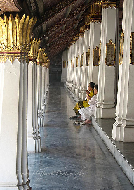 Thai women praying in The Grand Palace Temple. Bangkok, Thailand