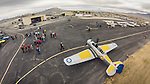 Open House at the WInnemucca Airport as photographed using the DJI Phantom quadcopter drone and GoPro Hero 3 camera from above the event. <br /> <br /> Aircraft on the ramp–North American T-6 Texan, WWII-era fighter/trainer with RAF colors