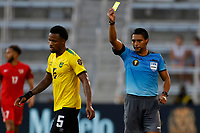 July 16th 2021; Orlando, Florida, USA; Referee Bryan Lopez shows the yellow card to Jamaica defender Alvas Powell  during the Concacaf Gold Cup match between Guadeloupe and Jamaica on July 16, 2021 at Exploria Stadium in Orlando, Fl.