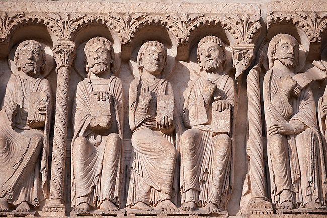 West Facade, Central Portal Lintel - General View c. 1145. Cathedral of Chartres, France . The lintel shows gothic sculptures of the twelve apostles. A UNESCO World Heritage Site. .