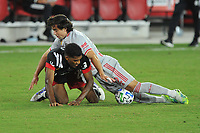WASHINGTON, DC - SEPTEMBER 12: Donovan Pines #23 of D.C. United battles for the ball with Brian White #42 of New York Red Bulls during a game between New York Red Bulls and D.C. United at Audi Field on September 12, 2020 in Washington, DC.