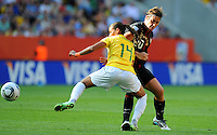 Abby Wambach (r) of team USA and Fabiana of team Brazil during the FIFA Women's World Cup at the FIFA Stadium in Dresden, Germany on July 10th, 2011.