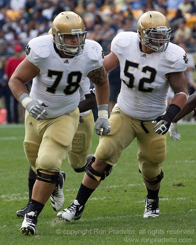 Notre Dame linemen Trevor Robinson (78) and Braxston Cave (52) pull out to make blocks.  The Notre Dame Fighting Irish defeated the Pitt Panthers 15-12 at Heinz field in Pittsburgh, Pennsylvania on September 24, 2011.