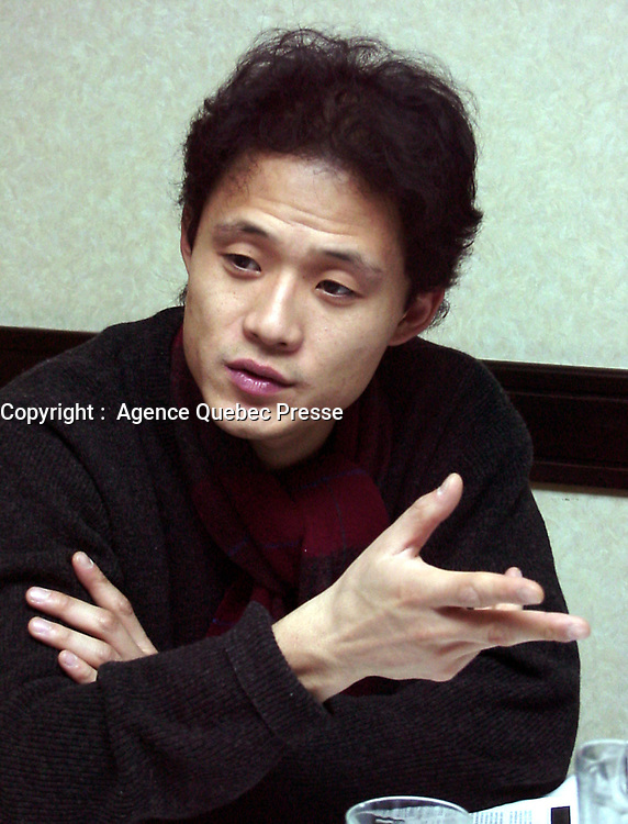 ID :  pr_99-12-04-A<br /> D & K :  Montreal, 1999-12-04. South-Korean filmmaker IL-Gon Song during an interview. He was attending the Amerasia film festival in Montreal (Quebec, Canada)<br /> KEYWORDS :   Canada, Montreal, Quebec<br /> Photo : (c) Pierre Roussel, 1999