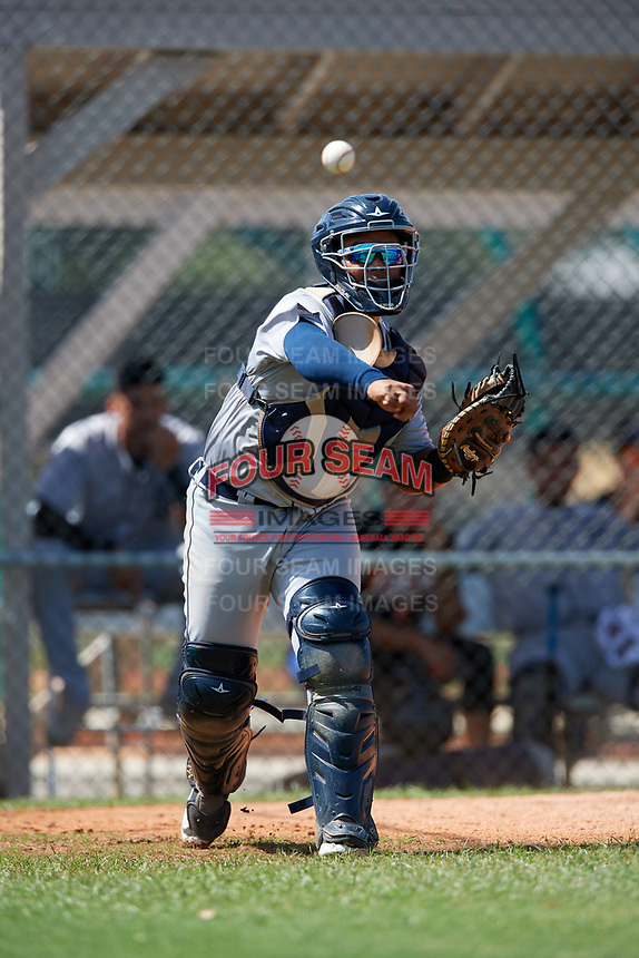 GCL Tigers West catcher Pedro Hurtado (18) throws to first base during a game against the GCL Tigers East on August 8, 2018 at Tigertown in Lakeland, Florida.  GCL Tigers East defeated GCL Tigers West 3-1.  (Mike Janes/Four Seam Images)