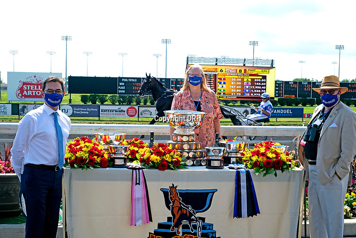 """August 8, 2020:  Hambletonian Society President John Campbell [L], CFO Moira Fanning [C], and Vice President Tom Charters prepare to present the winners trophy to the connections of  Romana Hill.  The 95th """"Hambo"""" was at the Meadowlands in East Rutherford, New Jersey. Dan Heary/Eclipse Sportswire/CSM"""